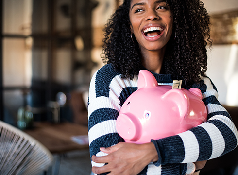 Young person holding piggy bank